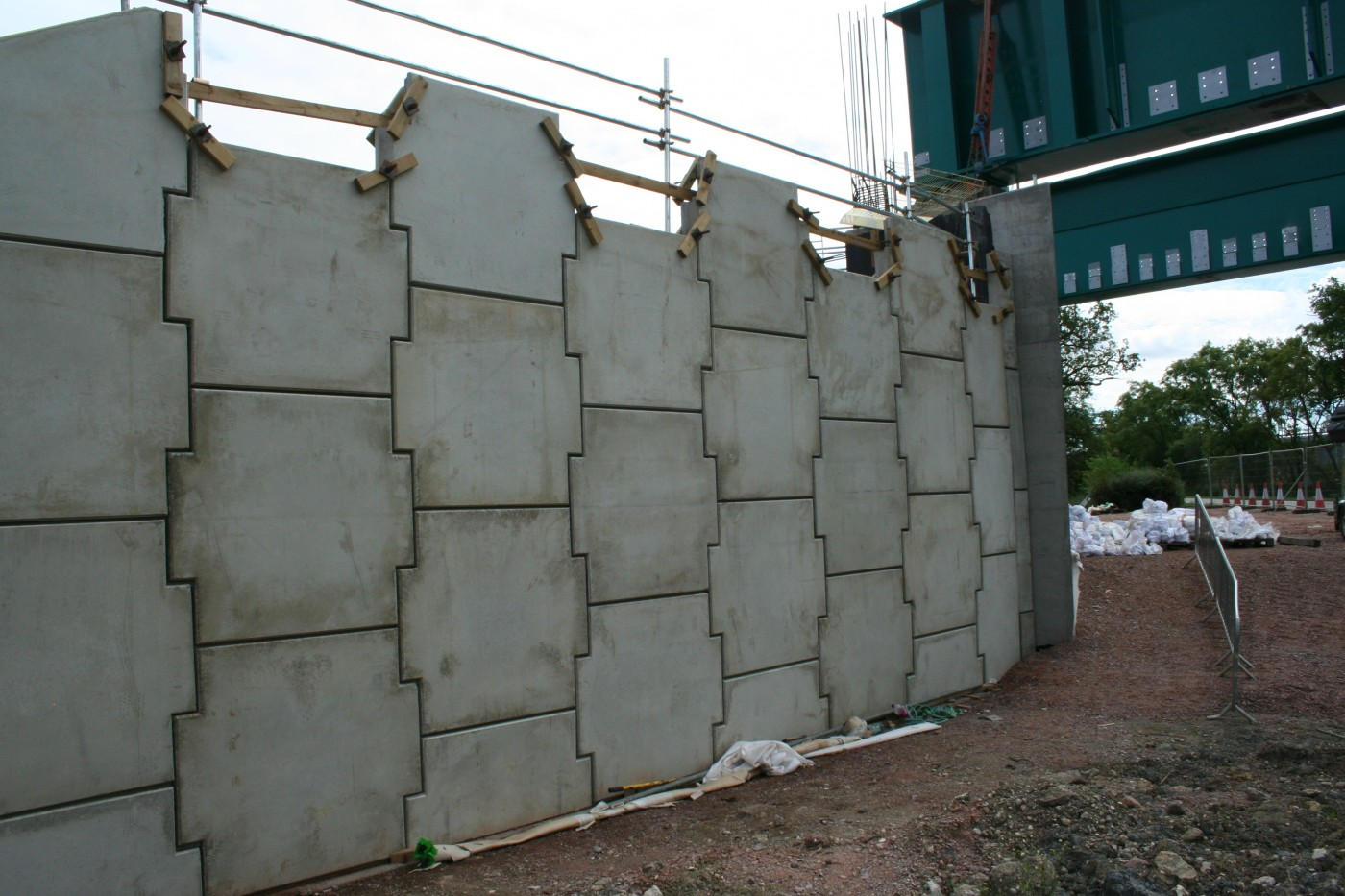 Concrete panel reinforced earth